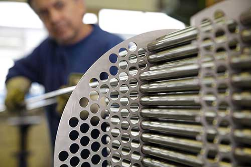 Employee working on a heat exchanger.